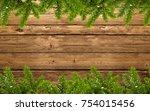 wood background with fir branch ... | Shutterstock . vector #754015456