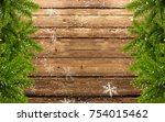 wood background with fir branch ... | Shutterstock . vector #754015462