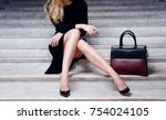 fashion model in black dress... | Shutterstock . vector #754024105