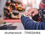 men wearing blue sweater using... | Shutterstock . vector #754026466