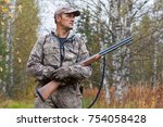 hunter with hunting gun walking ... | Shutterstock . vector #754058428