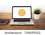 laptop computer on wood table... | Shutterstock . vector #754059532