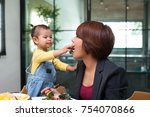 daughter is feeding the mother... | Shutterstock . vector #754070866