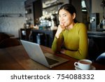 young asian girl with laptop... | Shutterstock . vector #754088332