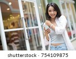 asia woman walking and using a... | Shutterstock . vector #754109875