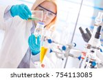 female laboratory assistant... | Shutterstock . vector #754113085