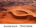 aerial view of high red dunes ... | Shutterstock . vector #754123606