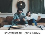 young couple sitting and... | Shutterstock . vector #754143022