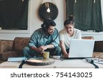 happy couple sitting and... | Shutterstock . vector #754143025