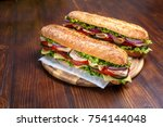 two baguette sandwiches with... | Shutterstock . vector #754144048