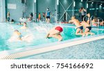 kids jumping into pool with... | Shutterstock . vector #754166692