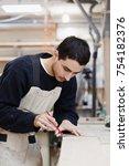 carpenter measuring wooden... | Shutterstock . vector #754182376