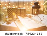 holy bible book with eyeglasses.... | Shutterstock . vector #754234156
