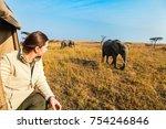 woman on safari game drive... | Shutterstock . vector #754246846