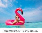 adorable little girl at beach... | Shutterstock . vector #754250866