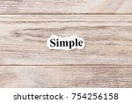 Stock photo simple of the word on paper concept words of simple on a wooden background 754256158