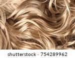 long blond hair as background | Shutterstock . vector #754289962