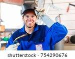 welder with welding device in... | Shutterstock . vector #754290676