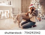 Stock photo merry christmas and happy new year handsome man is sitting near beautiful christmas tree at home 754292542