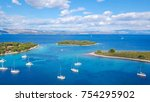 Aerial view of cozy mediterranean island. Blue lagoon, island paradise. Adriatic Sea of Croatia, popular touristic destination. Clear sea water. - stock photo