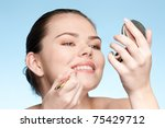 beautiful young adult woman...   Shutterstock . vector #75429712