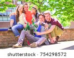 group of happy friends drinking ... | Shutterstock . vector #754298572