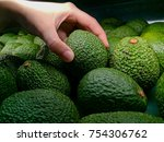 pick the perfect an avocado by... | Shutterstock . vector #754306762