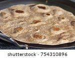 a whole wheat flour tortilla... | Shutterstock . vector #754310896