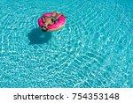 happy boy floating in a blue... | Shutterstock . vector #754353148