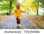 children in the autumn park... | Shutterstock . vector #754354486