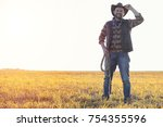 a man in a cowboy hat and a... | Shutterstock . vector #754355596