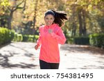 young attractive and happy... | Shutterstock . vector #754381495