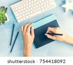 top view designer's hands... | Shutterstock . vector #754418092