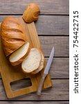 fresh sliced bread on wooden... | Shutterstock . vector #754422715