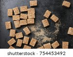 natural brown sugar cubes on... | Shutterstock . vector #754453492