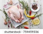 cooking raw chicken with herbs... | Shutterstock . vector #754459336