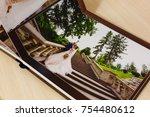 Small photo of Pages of wedding photobook or wedding album on white background