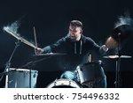 drummer rehearsing on drums... | Shutterstock . vector #754496332