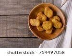 chicken nuggets on wooden plate.... | Shutterstock . vector #754497058