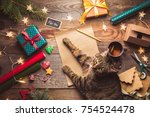 Stock photo beautiful christmas background with a new year daccor a sheet of old paper garland and gifts cup 754524478