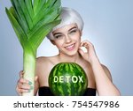 pretty girl with green leek and ...