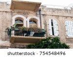 balconies of old european houses | Shutterstock . vector #754548496