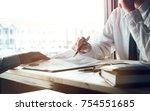financial advisor presenting... | Shutterstock . vector #754551685