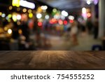 empty wood table top and blur... | Shutterstock . vector #754555252