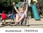Happy Child On Playground...