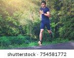 man running sprinting on road.... | Shutterstock . vector #754581772