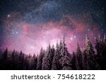 Stock photo magical winter landscape snow covered tree vibrant night sky with stars and nebula and galaxy 754618222