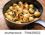 fresh fried chanterelle with... | Shutterstock . vector #754620022