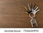 bunch of keys on a house shaped ...   Shutterstock . vector #754634992