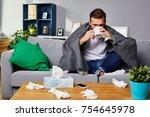 ill man drinking hot tea... | Shutterstock . vector #754645978